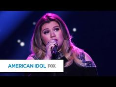 "Kelly Clarkson breaks down while performing an emotional song on ""American Idol."""