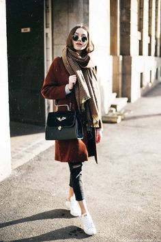 Pair a caramel-colored coat with a thick scarf and ripped jeans for a simple and casual winter look. Let Daily Dress Me help you find the perfect outfit for whatever the weather! dailydressme.com/