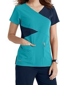 The Grey's Anatomy Signature mock wrap scrub top has detailed style lines and roomy pockets. Scrubs Outfit, Scrubs Uniform, Scrub Suit Design, Stylish Scrubs, Medical Uniforms, Womens Scrubs, Suit Accessories, Medical Scrubs, Professional Attire