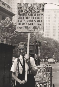 A man exercising his 1st amendment rights by protesting equality for women. Funny to think that this was actually something people believed in, when we have come so far that a thought like this probably doesn't cross by many minds.