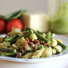 http://damndelicious.net/2012/07/21/pesto-pasta-with-sun-dried-tomatoes-and-roasted/