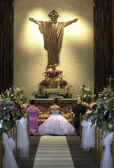 Praying at your Quinceanera mass. A shot from the back of the church is so dramatic