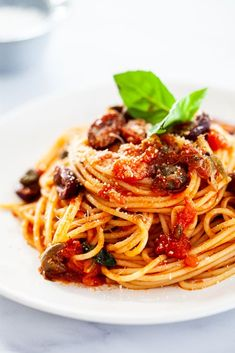 Pasta Puttanesca is the perfect pantry meal. Full of punchy flavors like olives, capers and garlic, it's a guaranteed showstopper. #Puttanesca #pasta Easy Potato Recipes, Yummy Pasta Recipes, Veggie Recipes, Healthy Recipes, Delicious Recipes, Top Recipes, Salmon Recipes, Casserole Recipes, Summer Recipes