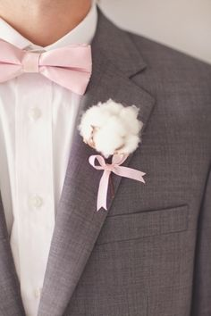 cotton boutonniere tied with pink ribbon // photo by nbarrettphotography.com