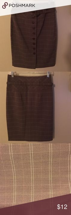 High Waisted Plaid Pencil Skirt Forever 21 high waisted, brown and tan plaid, button up pencil skirt.  Knee length. Machine washable. 75% polyester, 23% Rayon, 2% spandex Forever 21 Skirts Pencil