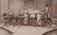 Vintage photograph of a high school class, and 8 bicycles (1896)