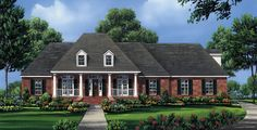 This beautiful Southern style home features an open floor plan with 4 spacious bedrooms.  House Plan # 351178.