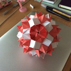#Kusudama designed by Natalia Romanenko. Folding from two-sided square #paper #red grid pattern 30 pieces. Assemble as a stellated icosahedron without glue. Lovely and sturdy.... #trending #etsy #petal #white #ball #modular #origami #folding #kusudama #handmade