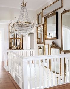 Mirror collection for stair well...nice.