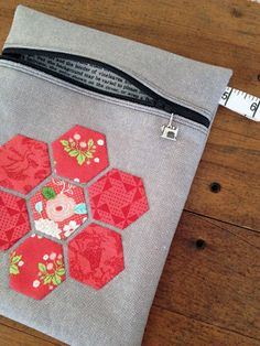 "Zippered pouch with English Paper Piecing (EPP) of hexagon (hexie) shapes using Lella Boutique's ""Goosberry"" line from Moda, and Moda's Cross Weave in graphite."