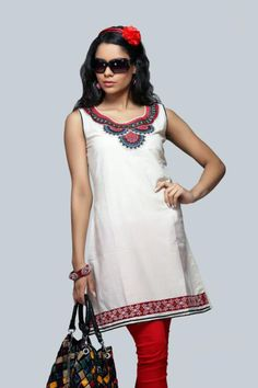 Code - 7254	  Off white cotton kurti with machine embroidery on the neckline.