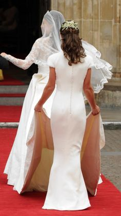 Probably *the* most famous bridesmaid's dress in history! Pippa Middleton wore this figure-flattering, ivory Alexander McQueen cowl necked dress as Maid of Honour at Catherine Middleton, Duchess of Cambridge marriage to Prince William in April 2011. A Wanaka Wedding (www.awanakawedding.co.nz).