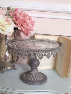 vintage cake stand in pewter.