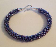 Purple iridescent beaded Kumihimo bracelet by Jewellery by Janine https://www.facebook.com/JewelleryByJanine