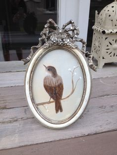 Cute bird, classic oval , sold