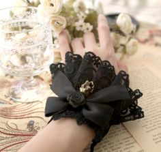 Over a hundred 包邮 the retro elegant hand roses skull gothic bow black lolita lace female bracelet - Taobao Lace Cuffs, Lace Gloves, Lace Bows, Lolita Fashion, Gothic Fashion, Broken Doll Costume, Lace Skull, Gothic Hairstyles, Baby Dress Patterns