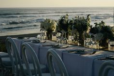 Opulent Balinese Wedding / Wedding Style Inspiration / LANE | White tables ocean view Silverwear and green centrepiece | Table setting ideas | Bali Wedding | Bali Event Hire