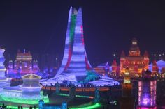 Harbin4 - Tourists play in the Harbin Ice And Snow World during its test run on Dec. 22, 2015