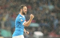 Napoli's Argentinian-French forward Gonzalo Higuain celebrates after scoring his third goal during the Italian Serie A football match SSC Napoli vs Frosinone Calcio on May 14 2016 at the San Paolo stadium in Naples. / AFP / CARLO HERMANN