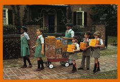 Girl Scouts selling cookies in the 1980s. The fun times and they all actually look like girl scouts not just a group of girls walking down the street. whatever happened to these times.