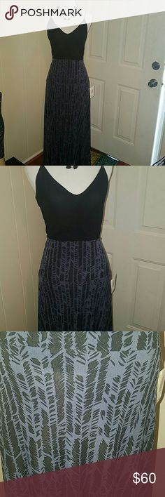 Lularoe XS Maxi Unicorn Skirt&Dress NWT attached. Gorgeous Unicorn printed Maxi Skirt/Dress  (*Can be worn either way , This print is like an Indigo and Black Arrow/Feathered Printed Maxi. Silky smooth and Perfect for Both Springtime&Summer... (Necklace,Shirt& mannequin not4sale) Brand new MAXI in Extra small , with tags still attached... If you're a small,  you can also fit this due to the type of fabric. It is very stretchy and Slinky smooth .Lularoe LuLaRoe Other