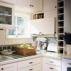 tap into the coat closet behiind fridge area for an appliance garage! door options.