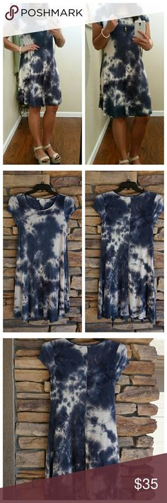Blue and White Tie Dye Dress A free spirited dress. A ribbed blue and white tie dye dress with a slight stretch. This flowy dress is made of 96% rayon and 4% spandex. Size Small. NWT. Dresses