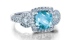 - 14K BLUE TOPAZ 1.85CTS AND DIAMOND .81CTS RING  $1,475 (SPRNG15154)