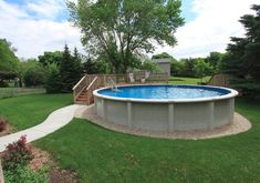 Above ground pool with partial deck and sidewalk. More