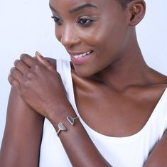 Description Details    Created using up-cycled brass and horn, The Split Moon Cuff welcomes the changing season with ease.   Recycled brass is cast, polished and handcrafted by Kenyan artisans using heritage techniques. Handcrafted in Kenya Your purchase promotes artisan innovation + entrepreneurship Product Care Guide