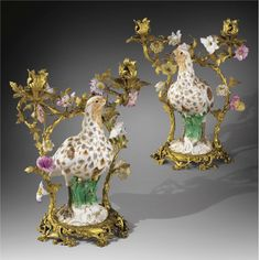 A PAIR OF GILTBRONZE MOUNTED PORCELAIN GREY PARTRIDGES CANDELABRA, THE PORCELAIN MEISSEN CIRCA 1750, THE MOUNTS POSSIBLY GERMAN MID. 18TH CENTURY