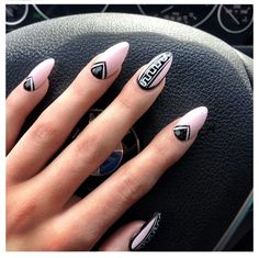 Tribal stiletto/almond pink and black nails!