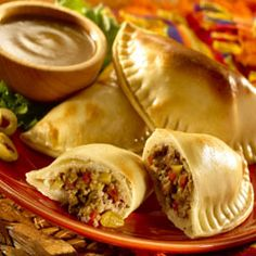 HAPPY CINCO DE MAYO RECIPES ... Pork Picadillo Empanadas Recipe ~ INGREDIENTS: Vegetable oil - Lean ground pork  Small onion, chopped - Golden raisins - Water - Pimiento-stuffed olives - Knorr® Chicken flavor Bouillon - Knorr® Garlic MiniCube - Frozen empanada dough (discos) - Egg