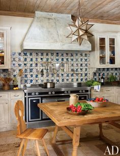 Ornamental range hoods give these stylish kitchens unique flair