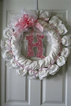 Cute Diaper Wreath. I think this will be part of the decorations at the next baby shower I go to/plan!!