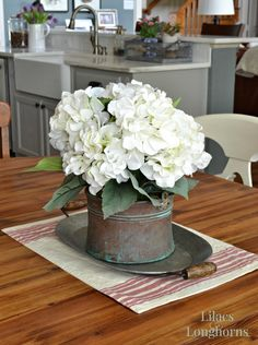 Hydrangea centerpiece with antique bucket and tray. #diyhomedecor