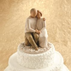 Message: Love ever endures - Anniversary Cake Topper - The popular Anniversary figure has been scaled down and affixed to a decorative base of carved flowers as a wonderful commemorative for wedding and anniversary events. For silver celebrations or golden milestones - or any year - it's a way to celebrate enduring love.