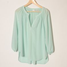 100% silk max studio Henley blouse Mint green, 3/4 sleeves, elastic at ends. Slightly longer in back, flowy, like new blouse. Beautiful color and fit. Max Studio Tops Tunics