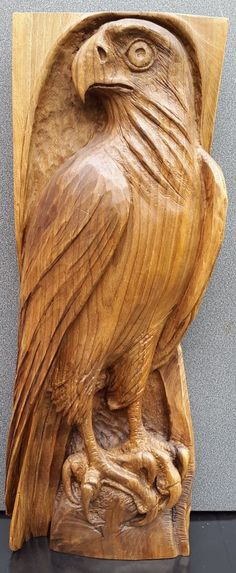 #sculpture by #sculptor NIKOLAY NIKOLOV titled: 'Falcon (Low Relief Bird of Prey Wooden Wall statue)'. #NIKOLAYNIKOLOV