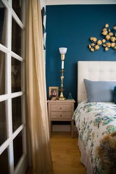 The wall paint is  Tucson Teal by Benjamin Moore, and the torchiere side lamps were found on eBay.