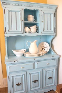 beautifully re-done hutch. I love the robin's egg blue. I love the country-ish style. I love her blog! #shabbychickitchencolors