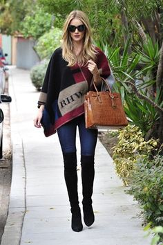 Best dressed - Rosie Huntington-Whiteley in a Burberry poncho and carrying a Michael Kors bag