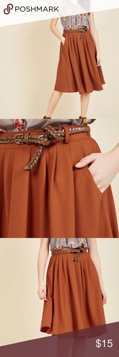 Beautiful Burnt Orange Tiger Lilies Skirt Burnt orange skirt from Modcloth (color appears to be discontinued).  This mid length skirt with pockets is super cute, and perfect for fall. Has belt loops, but no belt.  There are two tiny little stains, shown,  not very noticeable Modcloth Skirts Midi