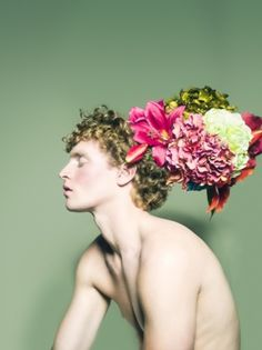 Ok this is disturbing... Boys with flowers in their hair. LOL!