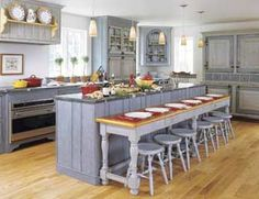 A Swedish-Style Kitchen -  					  						The client's love for Swedish style inspired the cabinetry, custom-made by designer and furniture-maker Kevin Ritter, for this gray and blue kitchen.