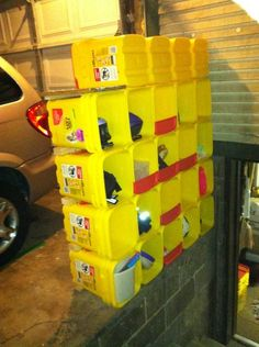 Re-purpose empty Kitty litter buckets into a storage station