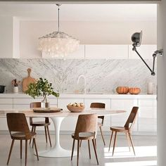"""Subtle femininity - you can never go wrong with marble in the kitchen IMO…"