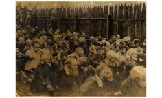 A group of Jewish men awaiting their fate at Chelmno.
