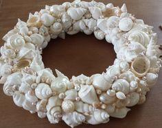 SeaShell Wreath, Handmade Shell Wreath White /Ivory/Cream, Beach Wedding Decor, Beach Wedding Gift by NatalieHaganDesigns on Etsy https://www.etsy.com/listing/206420032/seashell-wreath-handmade-shell-wreath