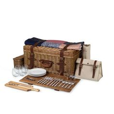 Charleston English Suitcase Style Willow Deluxe Picnic Basket. The Charleston is an English suitcase-style deluxe picnic basket and plenty of charm to spare. Top of the line basket with service for four. Includes stemless glasses, full-sized serving tray, and Festival Blanket, 824-99-805. Made of willow with leather trim.
